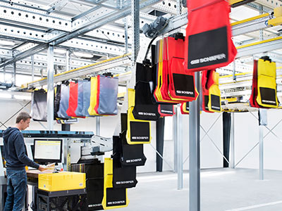 The modular pocket sortation system maximizes vertical space in a warehouse and provides storage and buffering of large volume SKUs.